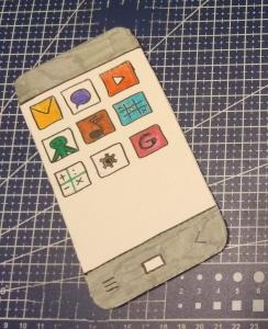 κινητό τηλέφωνο σε λευκό οντουλέ χαρτόνι